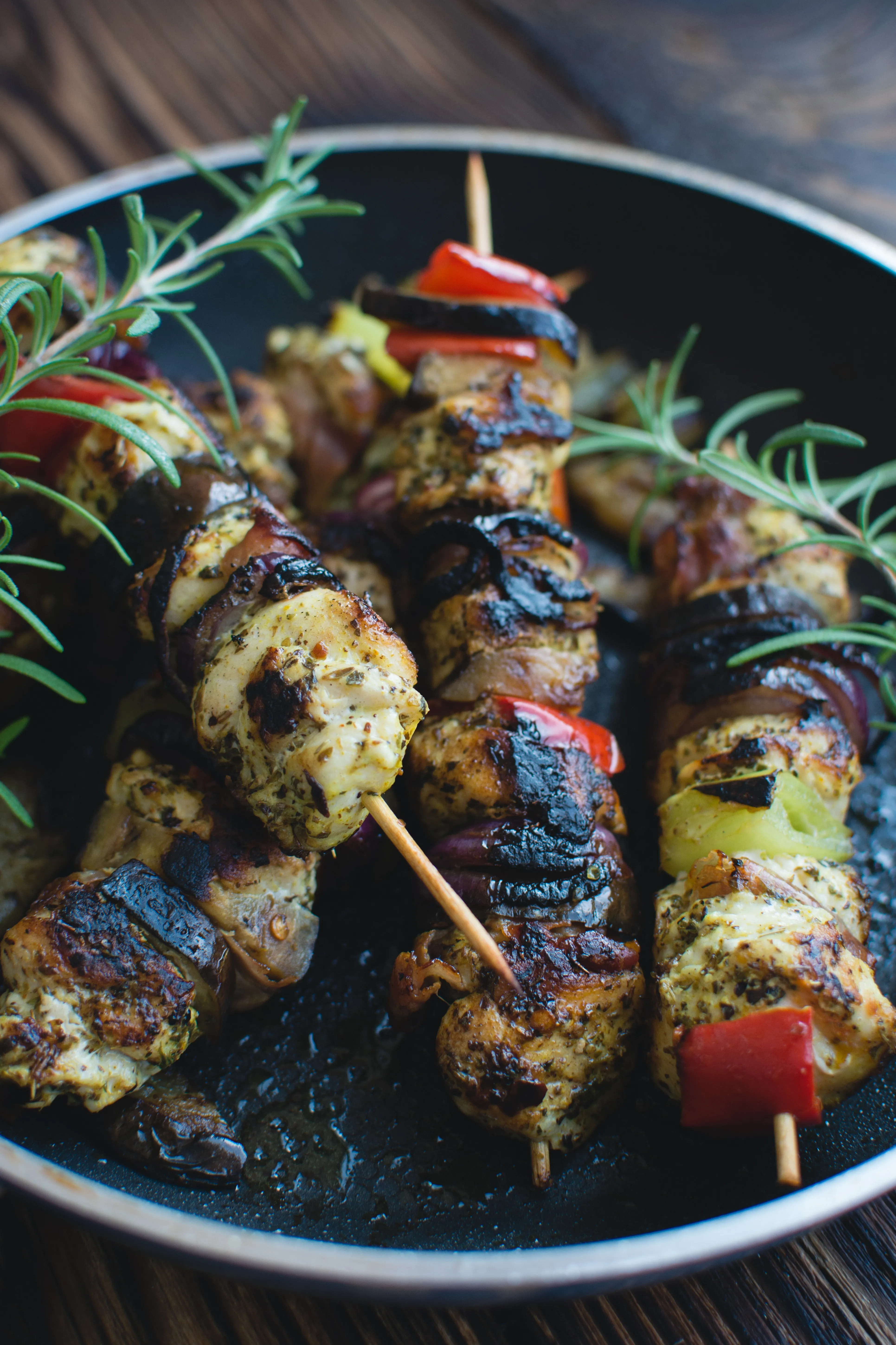 Chicken skewers on a wooden background