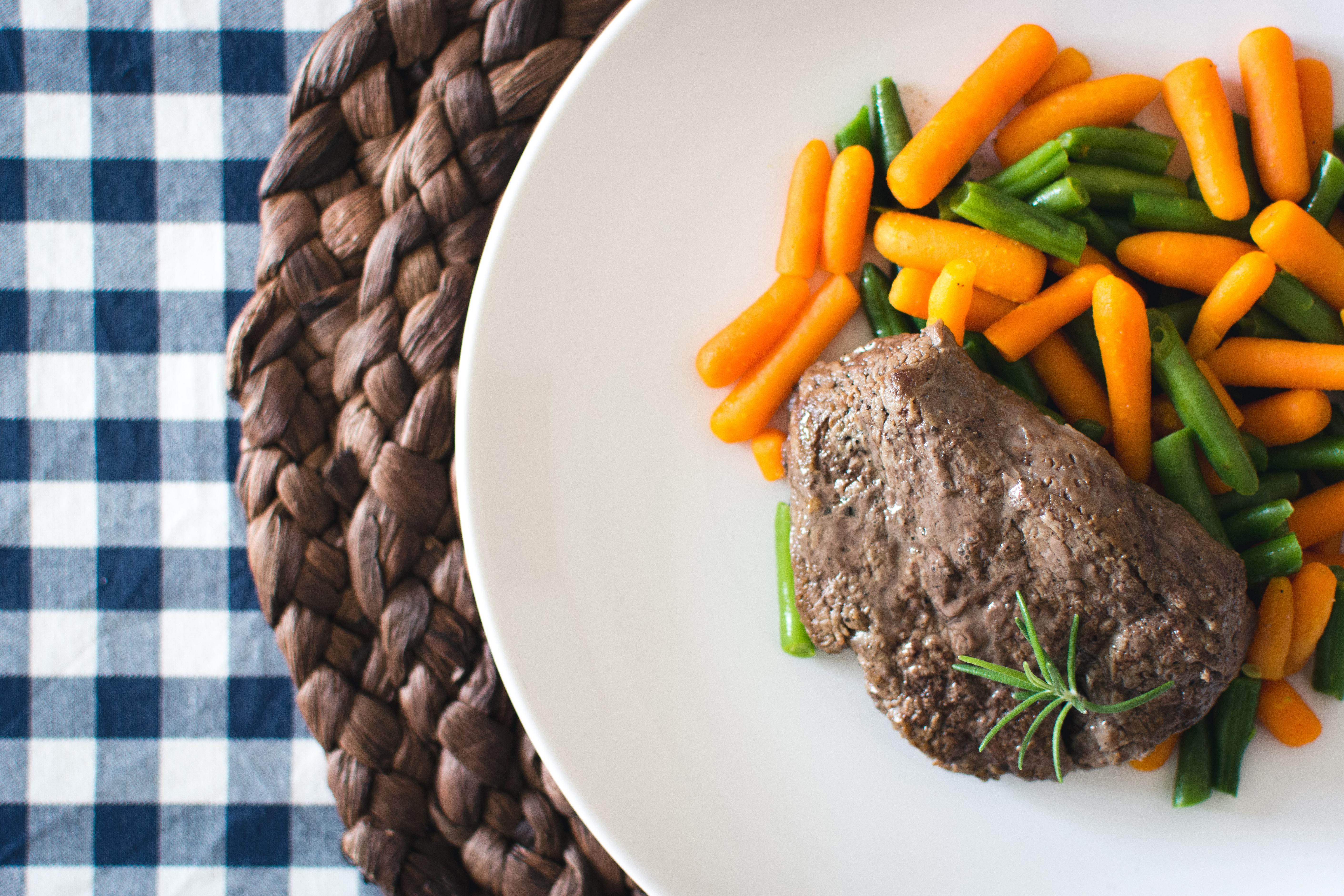 Beef steak with mini carrots and green beans
