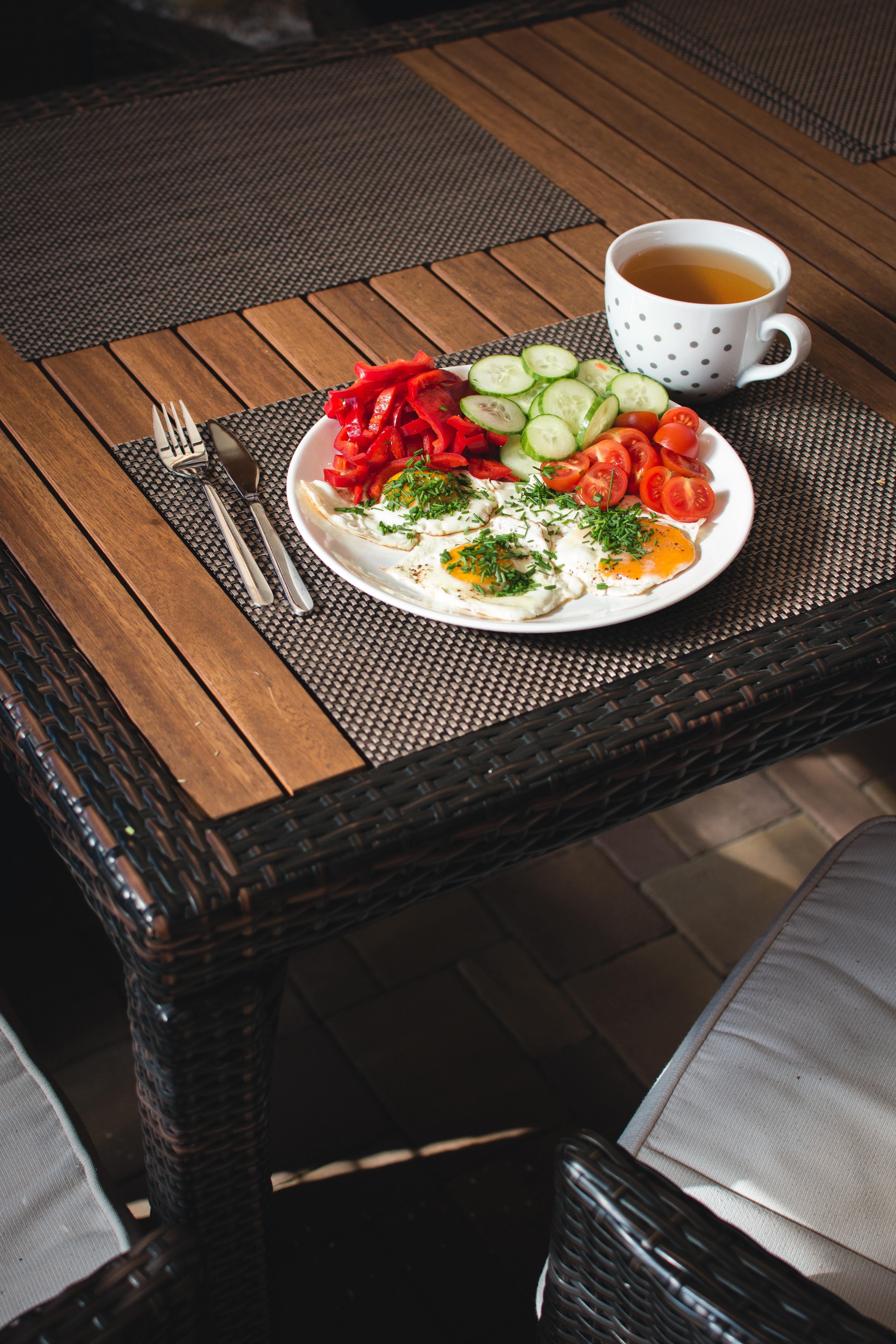 Paleo breakfast eggs with vegetables outside