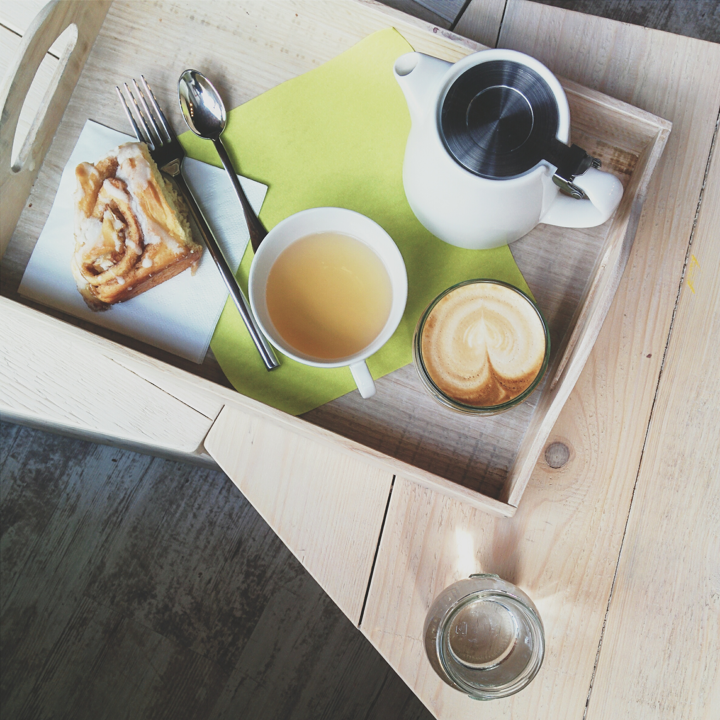 Cappuccino, tea and cinnamon roll