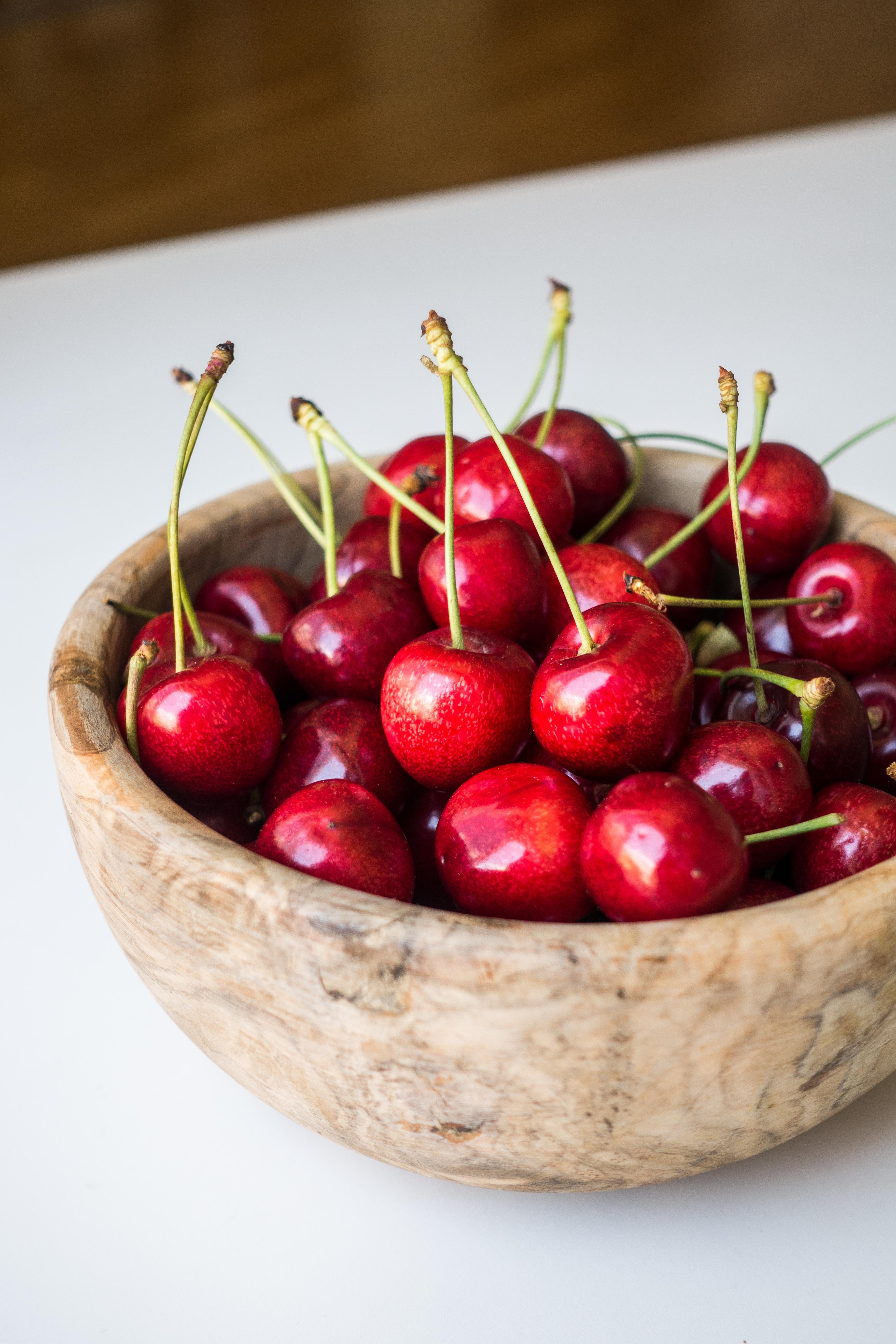 Fresh cherries in a wooden bowl