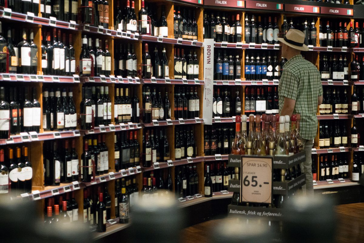 Man choosing wine in a wine store